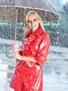 woman-in-raincoat-under-umbrella