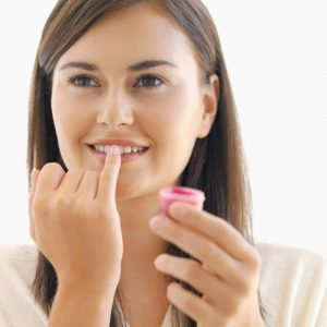 applying-lip-balm