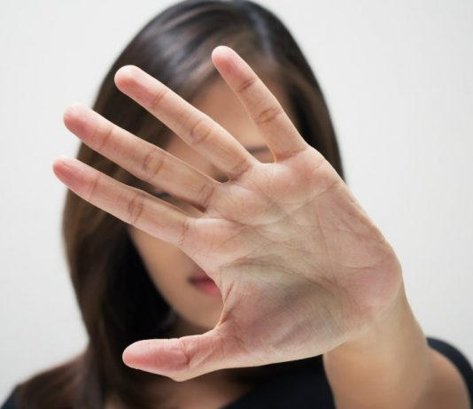 woman-with-hand-up